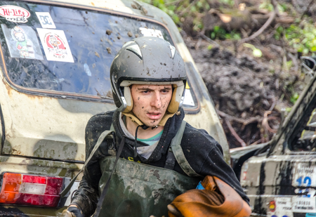 SALOVKA, RUSSIA - MAY 5, 2017: Jeep in mud and dirt splash at the annual car racing