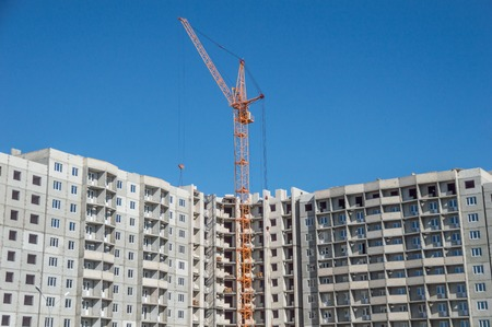 Multistorey housing under construction and highrise cranes Stok Fotoğraf