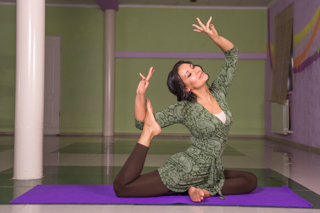 Professional yoga trainer working out in yoga in a studio