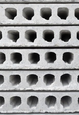 Stack of precast reinforced concrete slabs. Background Stock Photo