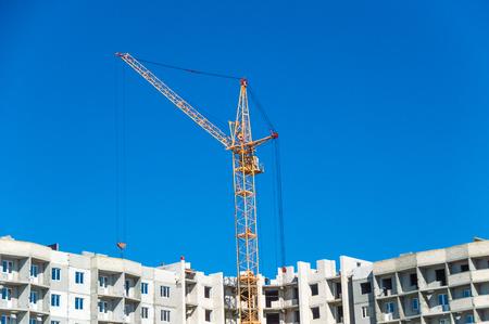 Housing development and large crane Stock Photo