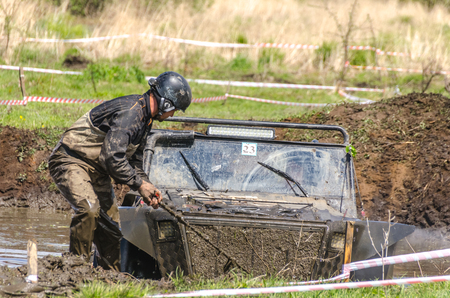 SALOVKA, RUSSIA - MAY 5, 2017: Jeep driving into mud at the annual car racing Trophy rubezh 2017