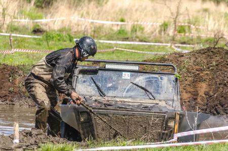 SALOVKA, RUSSIA - MAY 5, 2017: Jeep driving into mud at the annual car racing