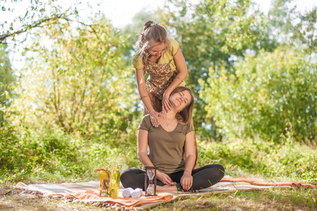 Proffesional masseuse impliments her massage abilities in nature. Imagens