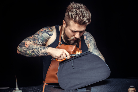 Leather Skinner produce a leatherwork in studio