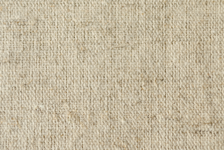 background of coarse linen with a texture of threads and weaves