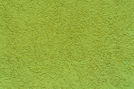 Background from green smooth decorative plaster on wall Reklamní fotografie