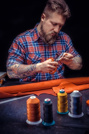 Skinner performs leather working for a new product