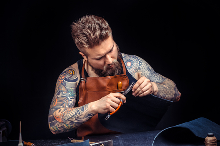 Leather Tanner cuts out leather goods