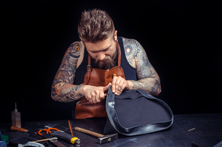 Leather Craftsman works as an artisan at the tanner shop