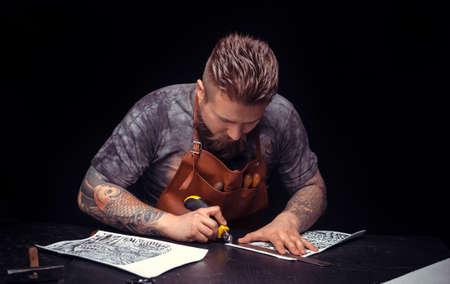 Professional Tanner creates a new leatherwork Stock fotó