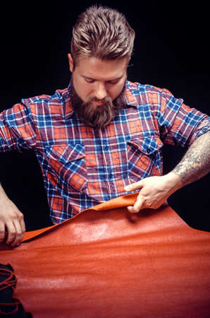 Leather Artist working on a new leather product Banco de Imagens