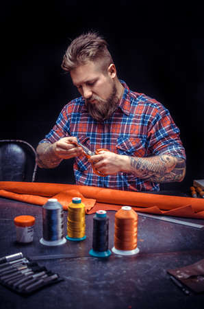 Craftsman focusing on his work at a workshop