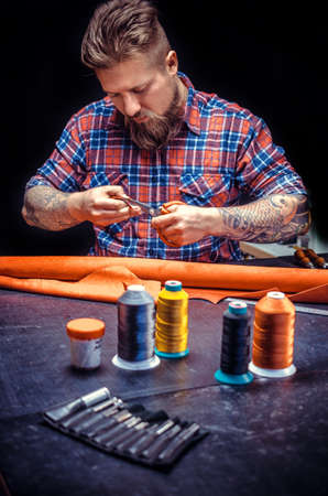 Leather Skinner produce a leatherwork in his work area