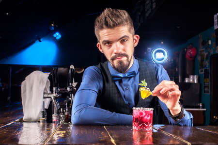 Bartender mixes a cocktail on the alehouse
