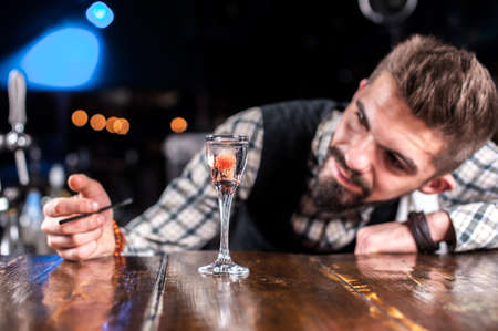 Barman formulates a cocktail in the brasserie