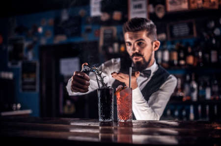 Bartender makes a cocktail in the public house
