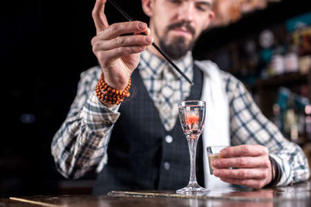 Bartender concocts a cocktail at the saloon