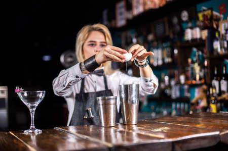 Girl bartender makes a cocktail at the brasserie Stok Fotoğraf