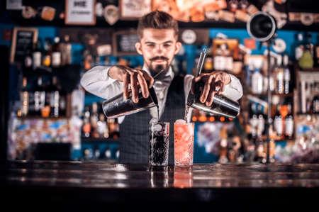 Bartender mixes a cocktail on the porterhouse