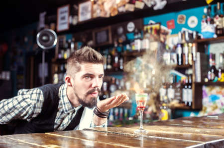 Professional bartending is pouring a drink at the bar counter