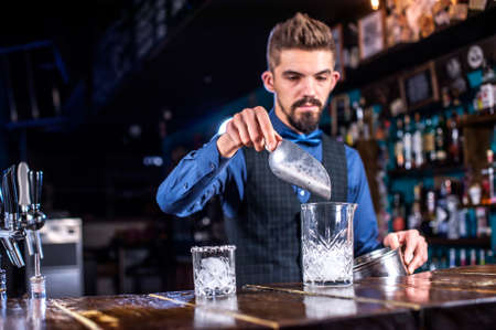 Bartender creates a cocktail at the taproom