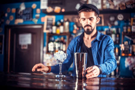 Bartender mixes a cocktail in the taproom