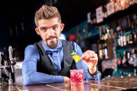 Professional bartending mixes a cocktail in pub