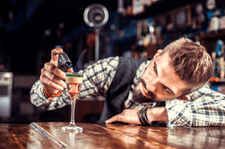 Barman mixes a cocktail in the saloon