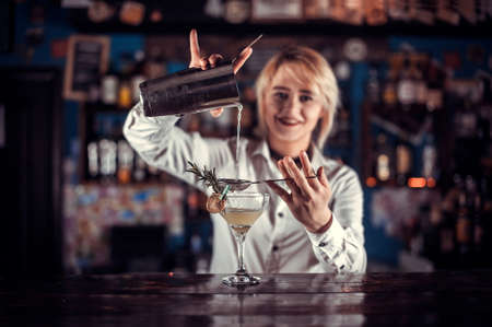 Girl barman concocts a cocktail on the porterhouse