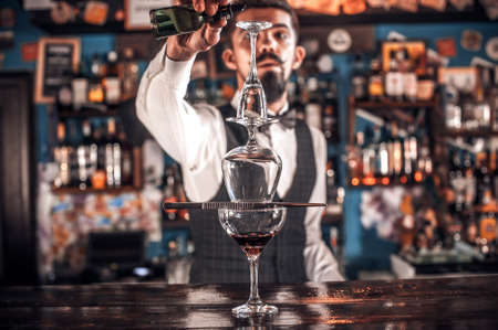 Barman mixes a cocktail in the beerhouse