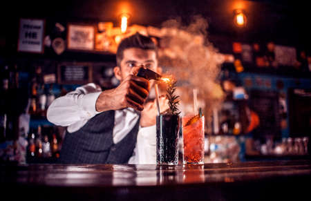 Bartender makes a cocktail in the beerhouse