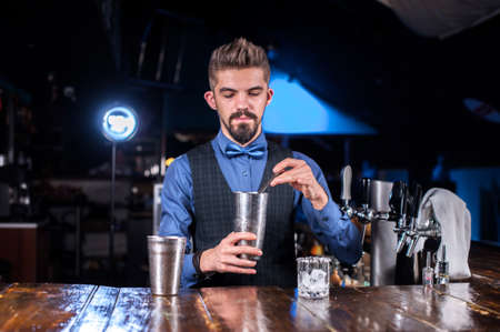 Barman formulates a cocktail at the porterhouse