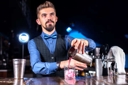 Bartender concocts a cocktail at the alehouse