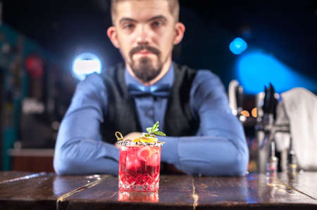 Bartender makes a cocktail on the beerhouse