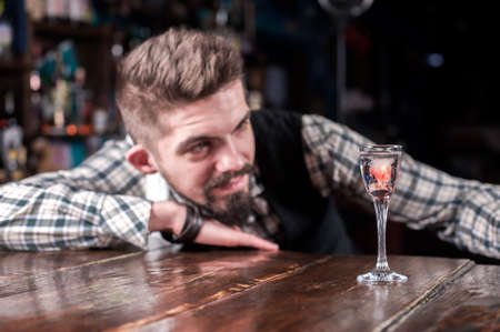 Barman mixes a cocktail on the alehouse