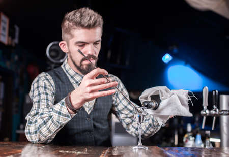 Barman creates a cocktail in the public house