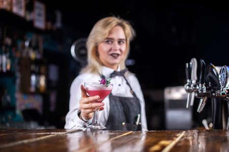 Girl barman mixes a cocktail on the public house Reklamní fotografie