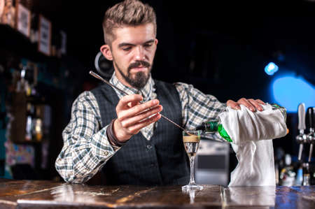 Barman concocts a cocktail at the taproom Reklamní fotografie - 159582917