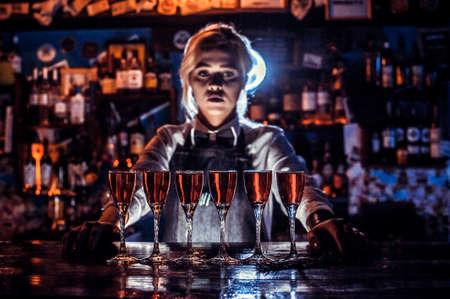 Girl bartender concocts a cocktail at the porterhouse Reklamní fotografie - 159582916