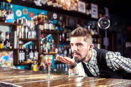 Barman mixes a cocktail on the taproom Reklamní fotografie