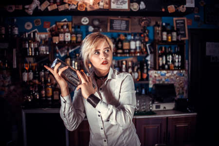 Girl bartender concocts a cocktail on the beerhall