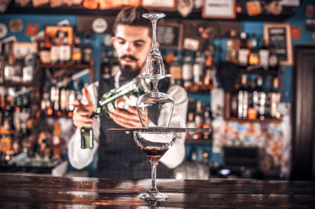 Barman makes a cocktail at the saloon Reklamní fotografie