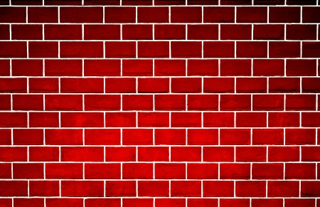 stucco background: red brick wall