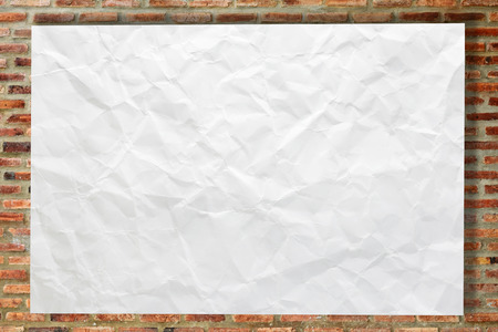 crinkled: White crumpled paper on brick wall for background