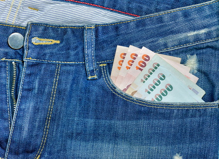 saving tips: money bank note  in jeans pocket Stock Photo