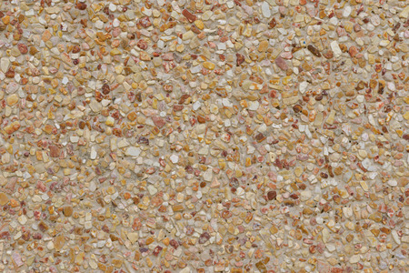 aggregate: rough texture surface of exposed aggregate finish, Ground stone washed floor, made of small sand stone in light brown color