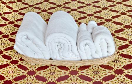 bath towel: white bath towel stack in the basket