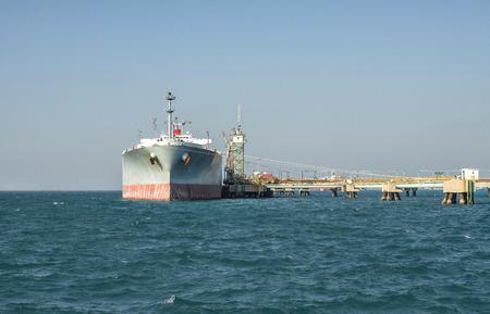 lng: ship tanker lng gas in port blue sky