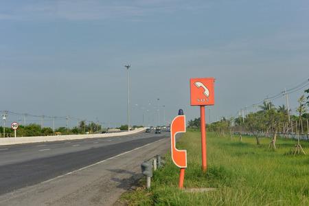 road shoulder: sos telephone emergency call on highway